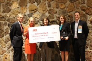 Kim Barnes, President & CEO of The Callaway Bank, accepts the award from BKD.